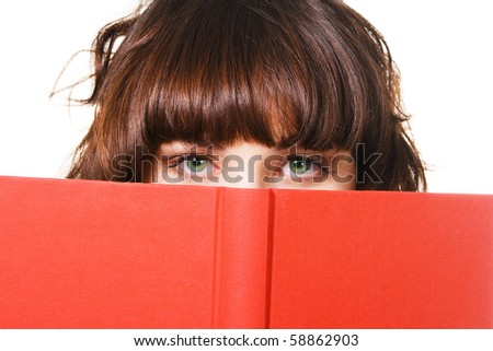 Closeup portrait of cute brunette with a red book - stock photo
