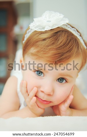 closeup portrait of cute girl with lace bow
