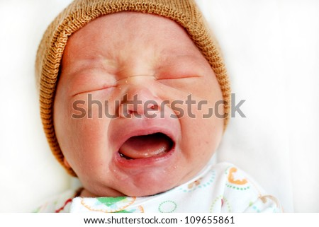 Closeup portrait of cute little baby boy crying