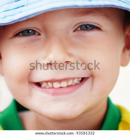 Closeup portrait of cute little boy smiling