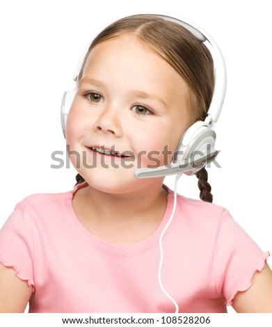 Closeup portrait of cute little girl talking to customers as a consultant using headset, isolated over white