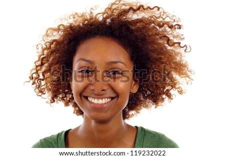 Closeup portrait of cute young black woman smiling isolated over white background