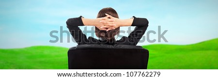 Closeup portrait of cute young business woman from behind dreaming, resting and imagine idyllic view