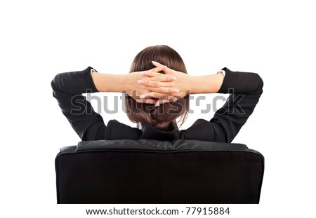 Closeup portrait of cute young relaxed business woman from behind with open hands behind her head