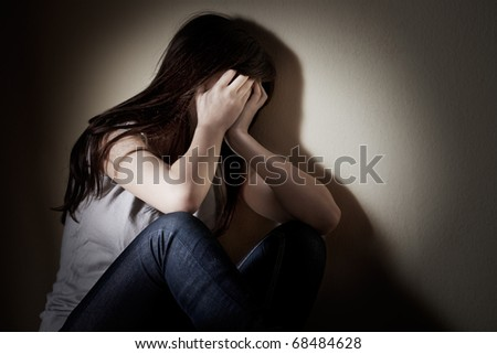 Closeup portrait of depressed teenager girl cover her face.