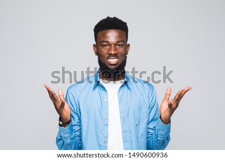 Closeup portrait of dumb clueless young man, arms out asking why what's the problem who cares so what, I don't know. Isolated on white background. Negative human emotion facial expression feelings