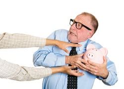 Closeup portrait of elderly, shocked senior business man, grandfather, holding piggy bank, looking scared, trying to protect his savings from being stolen isolated on white background. Financial fraud