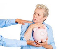 Closeup portrait of elderly, shocked senior business woman, grandmother, holding piggy bank, looking scared, trying to protect her savings from being stolen isolated white background. Financial fraud