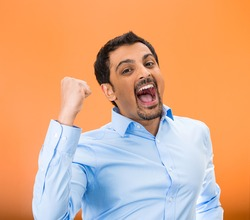 Closeup portrait of excited, energetic, happy, screaming student, business man winning, arms, fists pumped, celebrating success, isolated orange background. Positive human emotion, facial expression