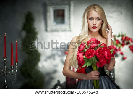 Closeup portrait of fashion model posing with bunch of peonies - stock photo
