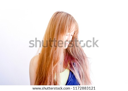 Closeup portrait of female model holding messy hair in hands, Combing with brush and pulls long hair, Daily preparation for looking nice, Long Disheveled Hair, Holding Messy Hair