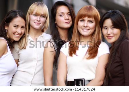 Closeup portrait of five urban women outside