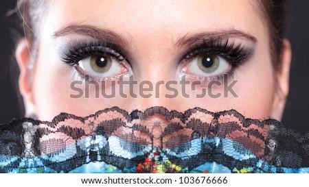 closeup portrait of flamenco dancer with fan