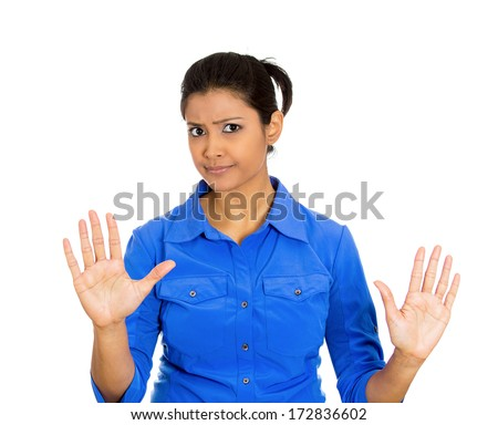 Closeup portrait of furious mad angry annoyed displeased young woman raising hands up to say no stop right there isolated on white background Negative human emotion facial expression sign symbol