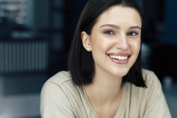 Closeup portrait of gorgeous young woman smiling with natural makeup and healthy skin.
