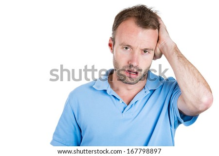 Closeup portrait of groggy upset, worried, sad depressed, tired business man with headache, very stressed hand in hair, isolated on white background. Negative human emotion facial expression, feelings