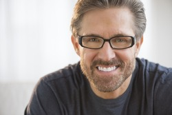 Closeup portrait of handsome mature man wearing glasses