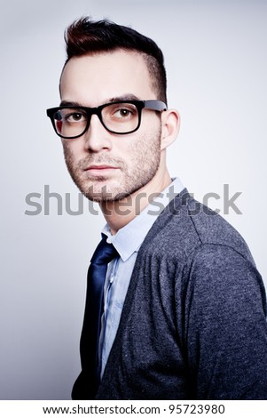 closeup portrait of handsome young adult man wearing glasses