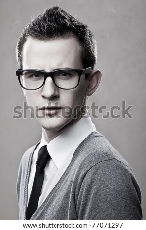 closeup portrait of handsome young adult wearing glasses - stock photo