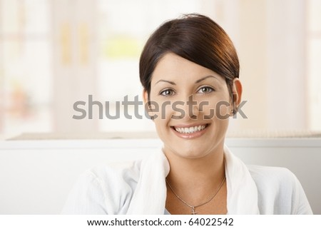 Closeup portrait of happy attractive woman at home, smiling.?