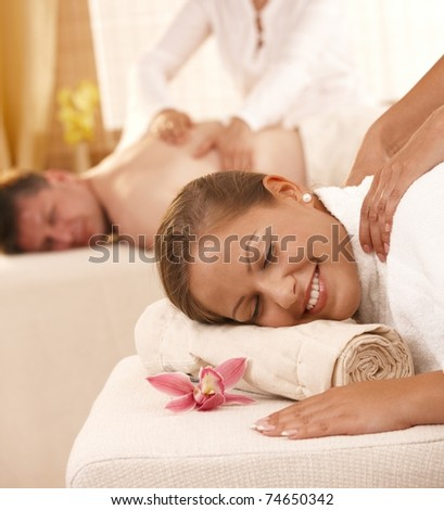 Closeup portrait of happy couple having back massage in day spa.?