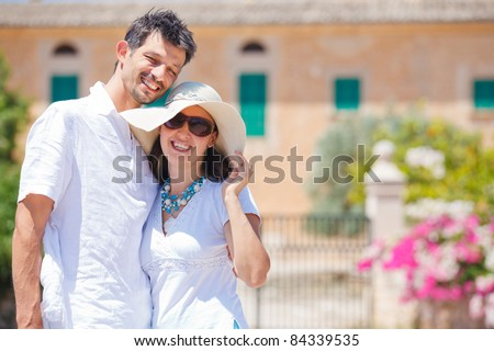 Closeup portrait of happy couple standing in front of the villa. Mallorca. Spain