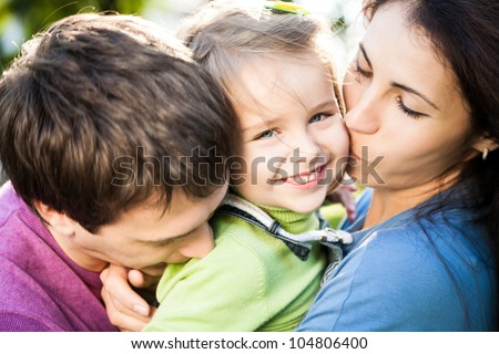 Closeup portrait of happy family outdoors in autumn