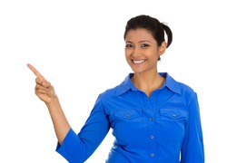 Closeup portrait of happy pretty confident young smiling woman gesturing pointing to space at left isolated on white background. Positive human emotion signs symbol, facial expression feelings