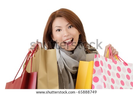 Closeup portrait of happy shopping woman holding bags over white.