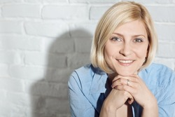 Closeup portrait of happy smiling blonde woman looking at camera.