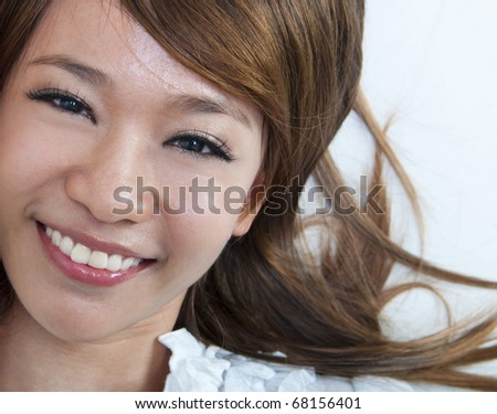 Closeup portrait of happy young girl lying on ground