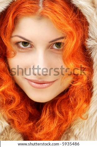 closeup portrait of lovely redhead in fur