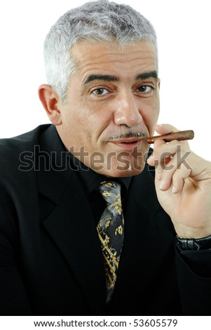 Closeup portrait of mature businessman smoking a cigar. Isolated on white.