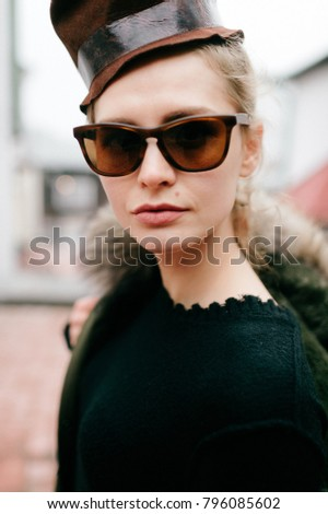 Closeup portrait of odd bizarre kinky beautiful cute young famous celebrity fashion caucasian blonde model woman in rich modern trendy sunglasses. Lovely girl posing for camera in stylish clothing #796085602