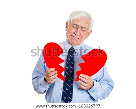 Closeup portrait of old man, senior executive, businessman, corporate employee, mature guy, holding broken heart in his hands, about to cry, isolated on white background. Human emotions, expressions