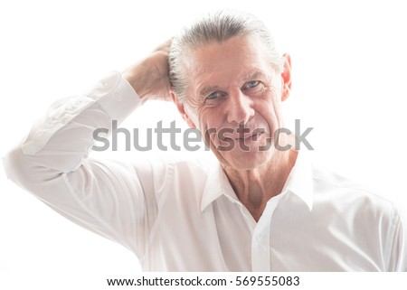 Closeup Portrait of Optimistic Confused Senior Man #569555083