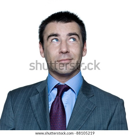 Closeup portrait of pensive handsome smiling man looking up in studio on isolated white background