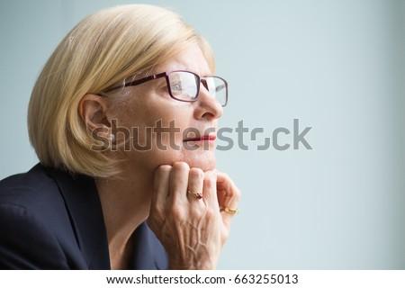 Closeup Portrait of Pensive Senior Business Woman #663255013