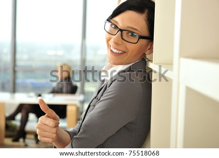 Closeup portrait of pretty cheerful business woman in an office environment