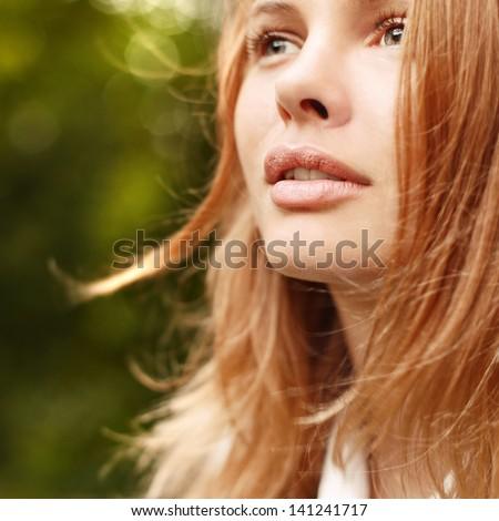 Closeup portrait of pretty cute beautiful woman in park