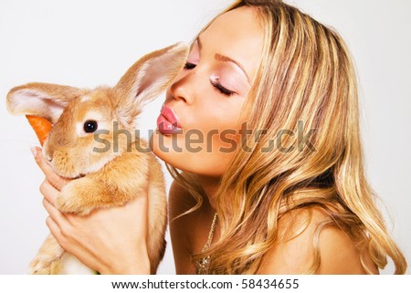 Closeup portrait of pretty girl with a rabbit