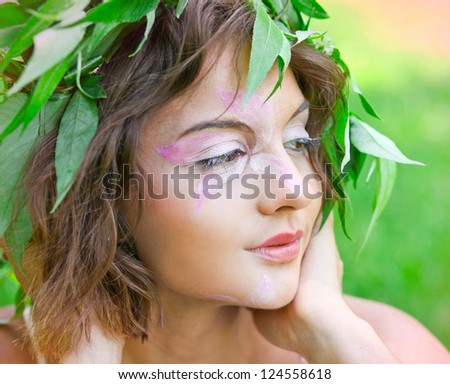 closeup portrait of pretty tender beautiful young female face with clear skin and delicate complexion in the summer evening sunshine in nature
