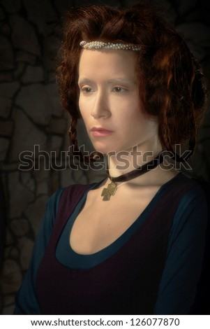 Closeup portrait of redhead woman stylized as old picture