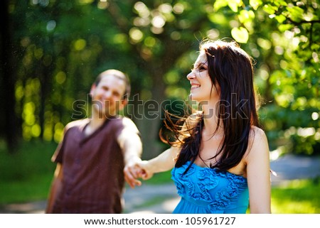 Closeup portrait of romantic young love couple in a park