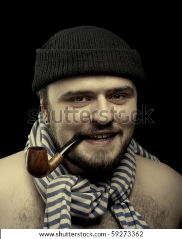 Closeup Portrait of sailor with pipe in his mouth