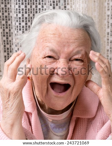 Closeup portrait of scared shouting old woman at home. Negative emotions