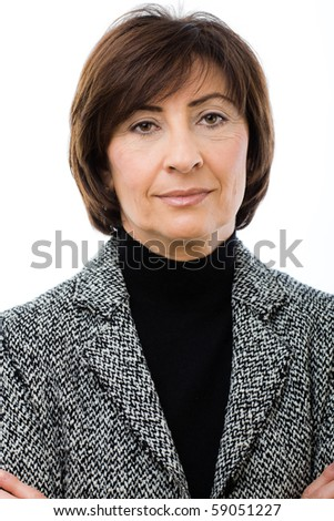Closeup portrait of senior businesswoman wearing grey suit, smiling and looking at camera. Isolated on white background.