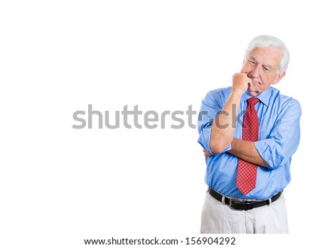 Closeup portrait of senior elderly mature man with subtle smile on his face trying to remember something in deep thought, good memories, isolated on white background with copy space