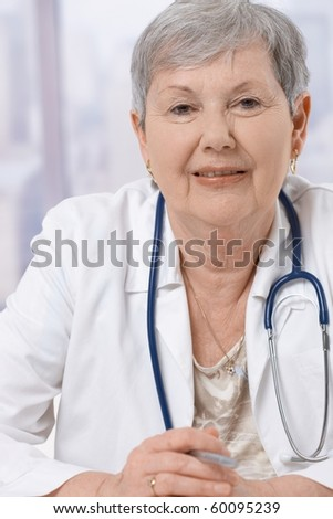 Closeup portrait of senior female doctor wearing stethoscope, smiling.?