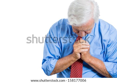 Closeup portrait of senior mature, elderly man very sad and depressed and almost to the point of crying, praying for forgiveness, isolated on white background with copy space. Human emotions